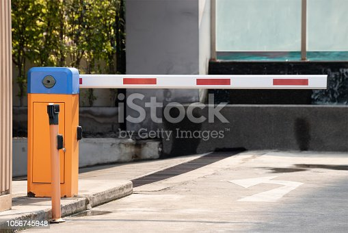 istock automatic barrier for home village security system. 1056745948