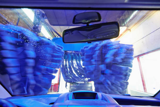 Automatic carwash tunnel station view from inside car stock photo