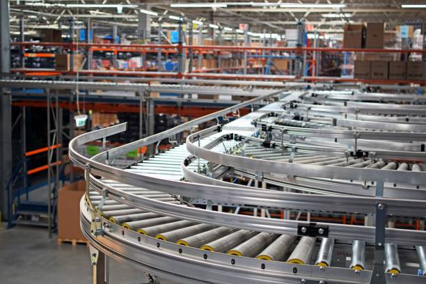 automatic conveyor belts in logistic center - conveyor belt stock photos and pictures