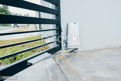 istock automatic door gate with motor 1010035504