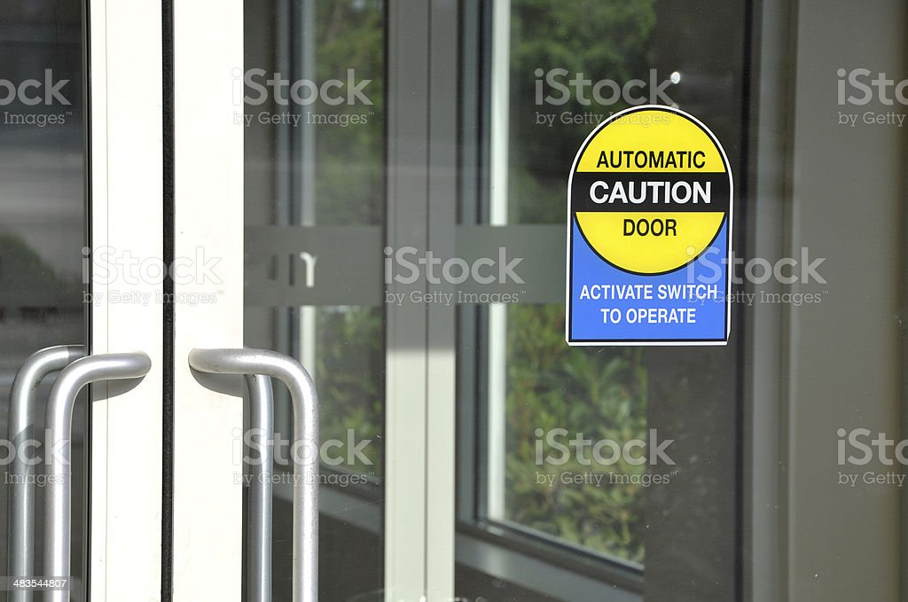 Automatic door with caution sign royalty-free stock photo
