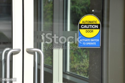 istock Automatic door with caution sign 483544807