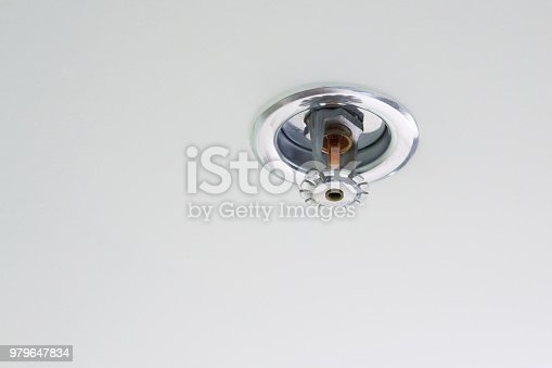Automatic fire extinguishing system on white ceiling, fire sprinkler indoor system