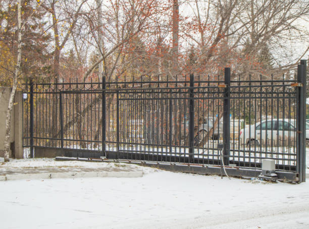 Automatic gate from a metal lattice for protection and safety of the private territory Automatic gate from a metal lattice for protection and safety of the private territory. security barrier stock pictures, royalty-free photos & images