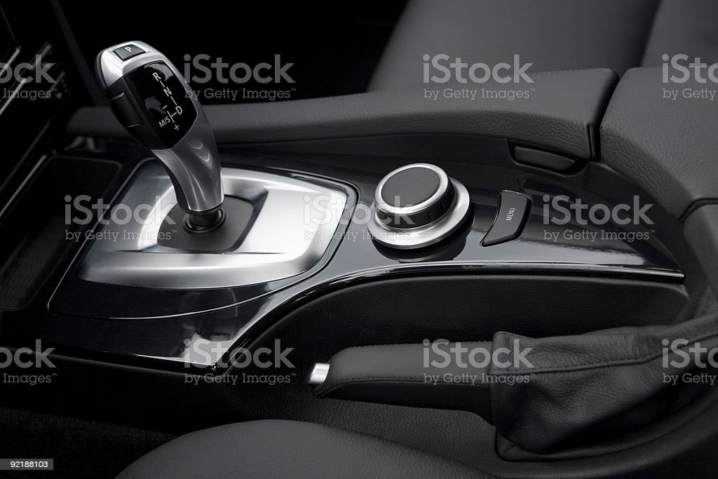 Automatic gear control and handbrake in a new car interior royalty-free stock photo