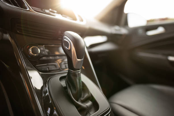 automatic gear stick of a modern car - car interior stock photos and pictures