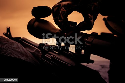 Automatic hunting rifle with optical scope close-up, sight adjustment when shooting
