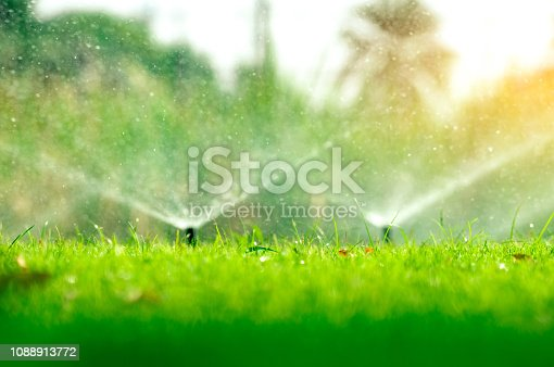 istock Automatic lawn sprinkler watering green grass. Sprinkler with automatic system. Garden irrigation system watering lawn. Water saving or water conservation from sprinkler system with adjustable head. 1088913772