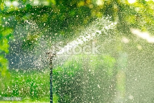 istock Automatic lawn sprinkler watering green grass. Sprinkler with automatic system. Garden irrigation system watering lawn. Water saving or water conservation from sprinkler system with adjustable head. 1093201882