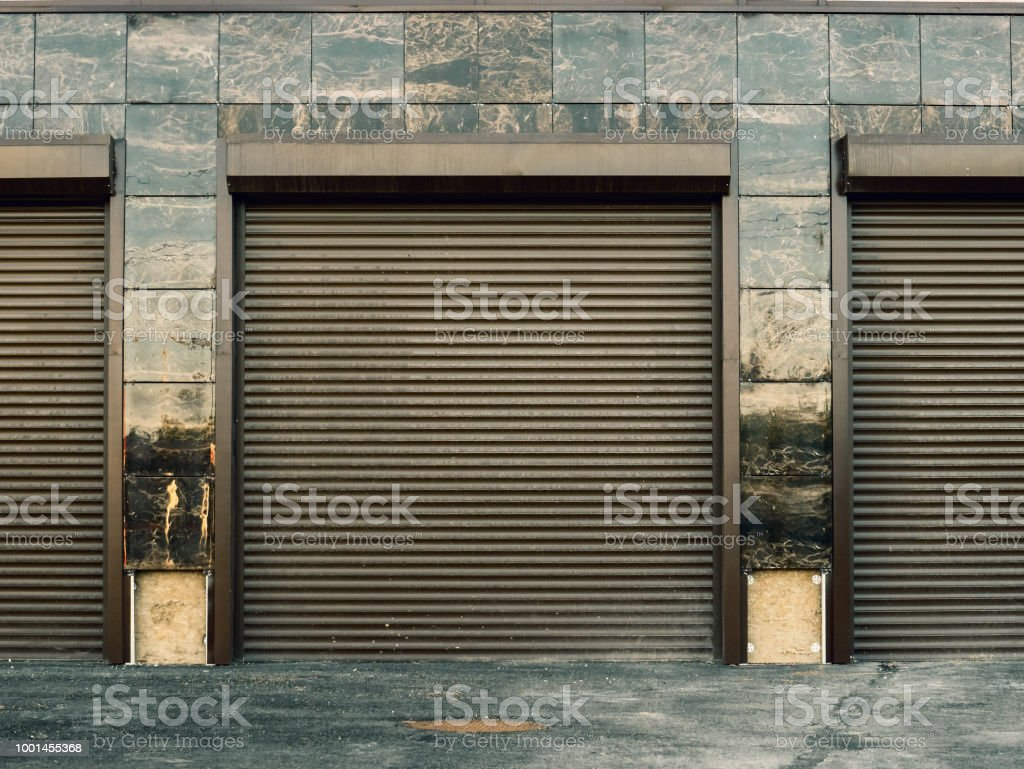 Automatic lift gates to garage car parking in new modern building,...