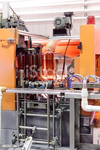 istock Automatic machine for blowing plastic PET bottles 652327964