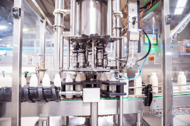 Automatic Milk Bottling Factory in Africa Africa, Industry, Business, Factory, Automatic - Fully Automatic Machine Filling the Fresh Milk in the Bottles dairy farm stock pictures, royalty-free photos & images