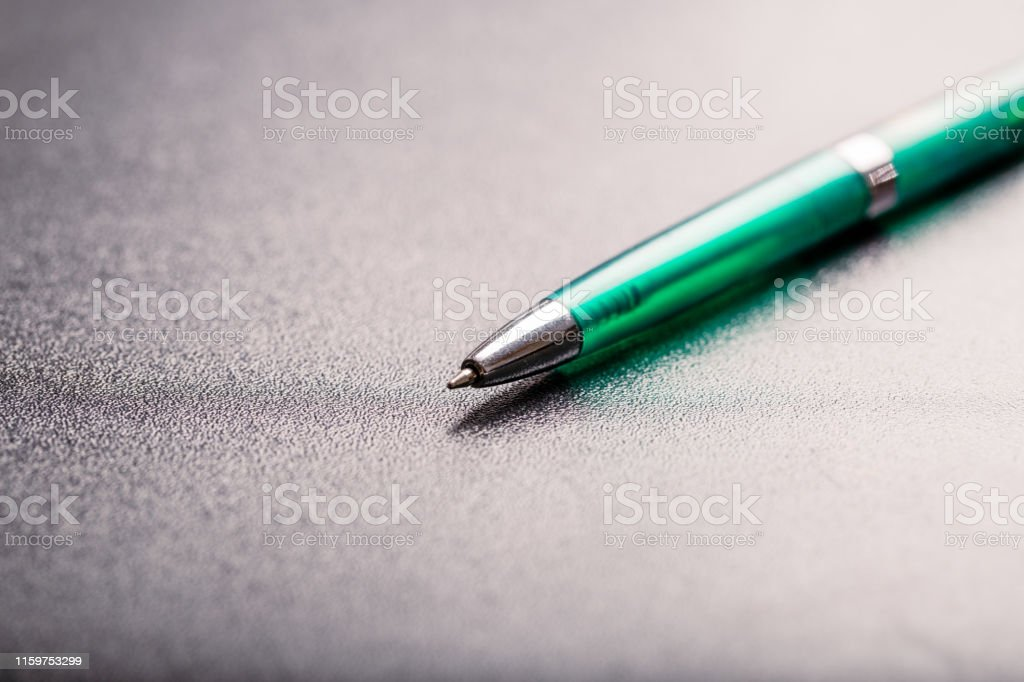 automatic plastic ballpoint pen with clipping path on black...