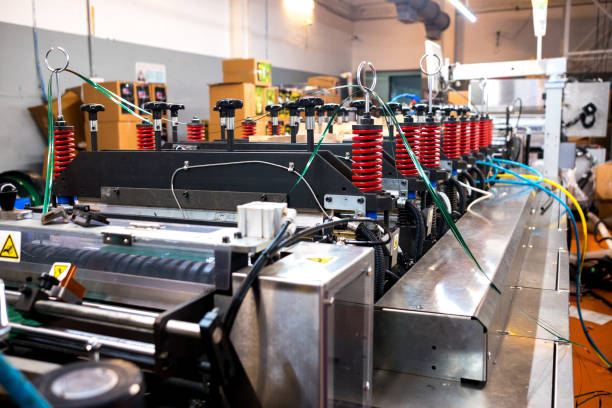 automatic plastic flat bottom bags making and printing  machine in modern factory, plastic packaging is mayor industrial manufacturing sector stock photo