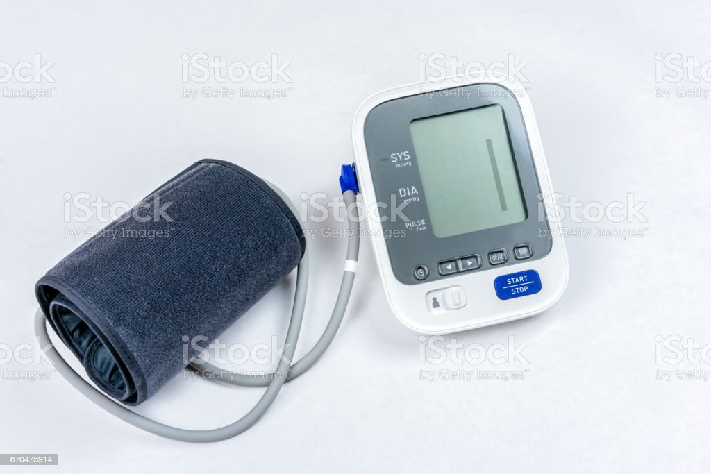 Automatic portable blood pressure machine with arm cuff isolated on white, shot from above. royalty-free stock photo