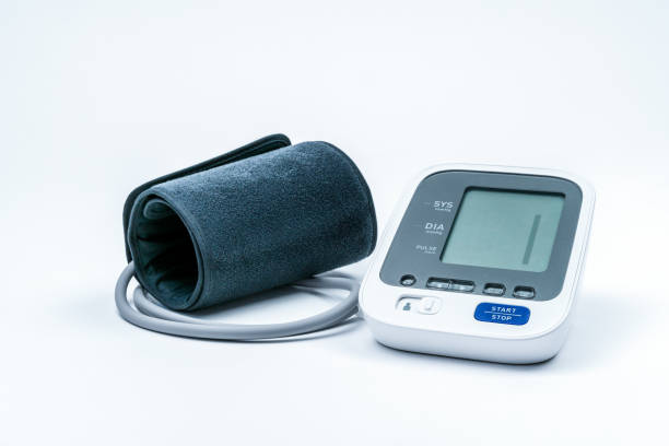Automatic portable blood pressure machine with arm cuff isolated on white with copy space, studio shot. stock photo