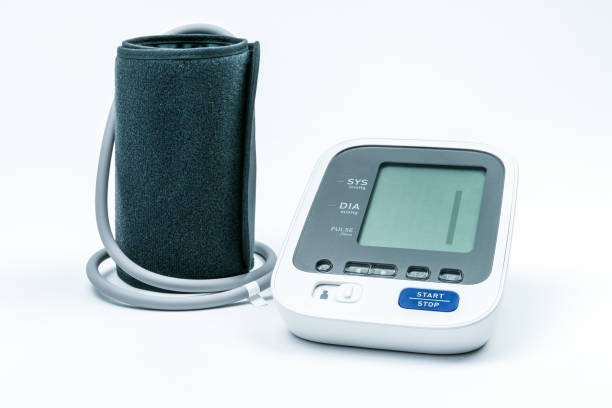 Automatic portable blood pressure machine with arm cuff isolated on white, studio shot. stock photo