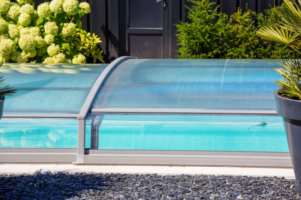 automatic retractable pool enclosure system to protect pool stock photo