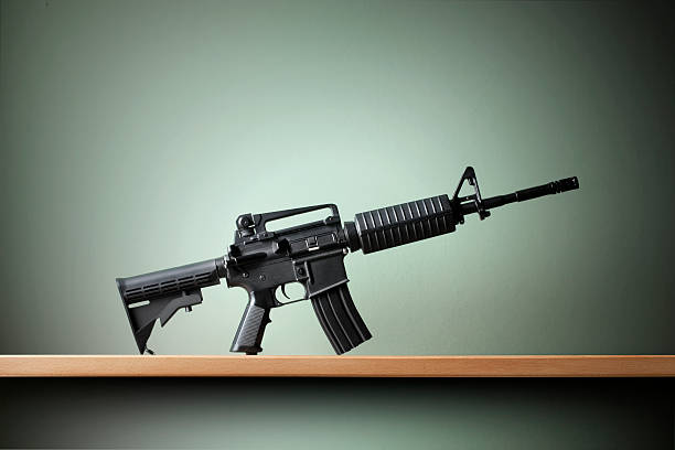 Automatic rifle AR-15 assault weapon on the shelf. ar 15 stock pictures, royalty-free photos & images