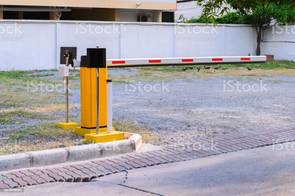 Automatic rising arm access barrier of buiding car park. stock photo