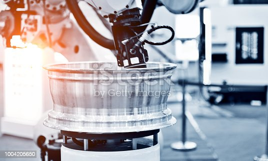 989526318 istock photo Automatic robot assembly line in factory 1004205650