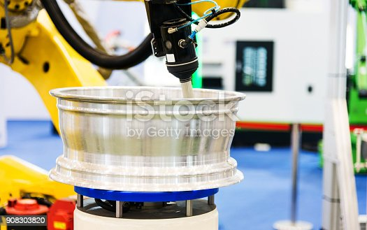 989526318 istock photo Automatic robot assembly line in factory 908303820
