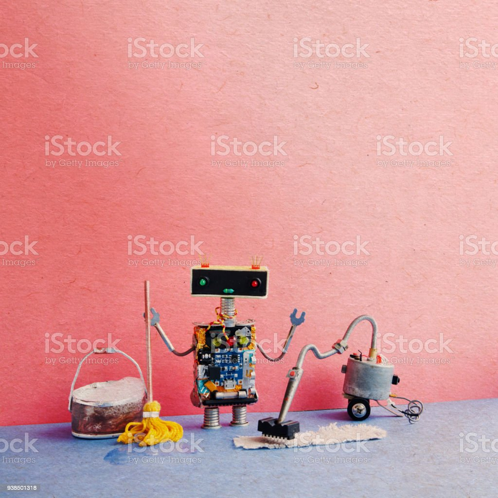 Automatic robot sweeper cleaning service. Creative design cyborg toy mopping clean-up with vacuum cleaner machine, yellow mop, bucket of suds water. Blue floor pink. Vintage textured paper background, copy space stock photo