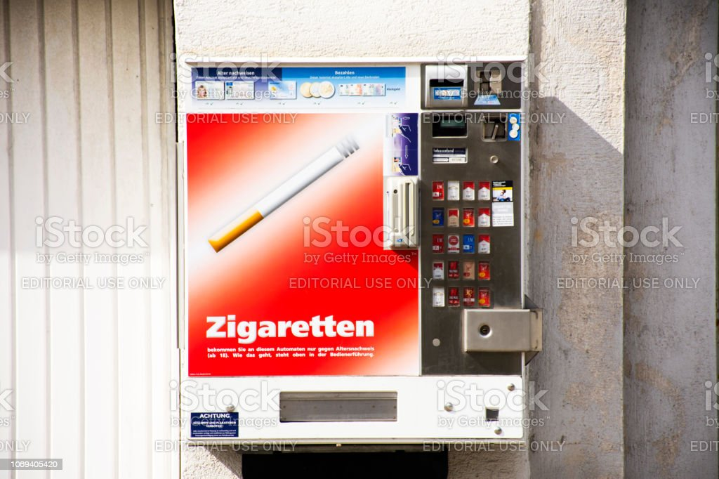 Automatic sale cigarette box on the wall beside road in Heidelberg, Germany stock photo