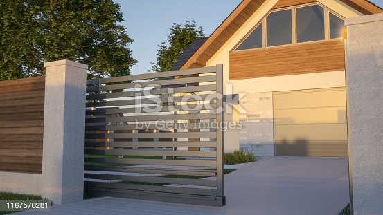istock Automatic Sliding Gate and house 1167570281