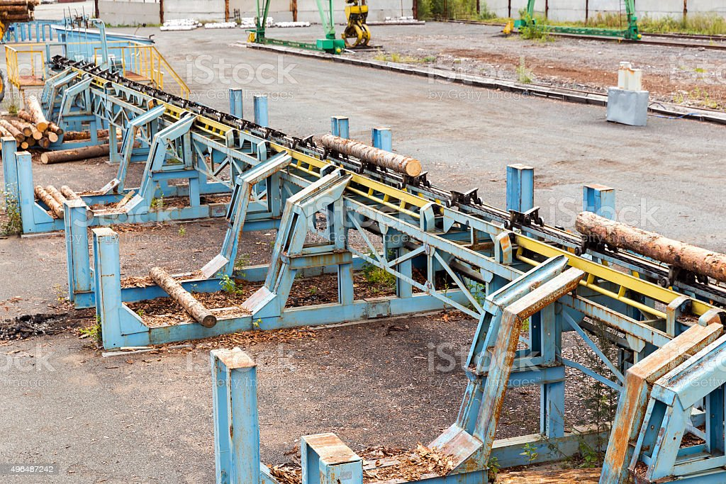Automatic sorting logs diameter at the sawmill Automatic sorting logs diameter at the sawmill 2015 Stock Photo