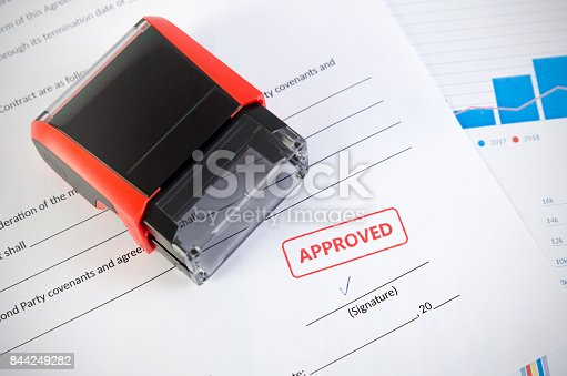 944422446istockphoto Automatic stamp on the contract document. Approved agreement 844249282