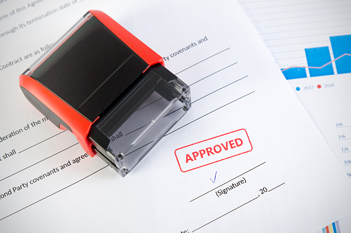 854317150 istock photo Automatic stamp on the contract document. Approved agreement 844249282