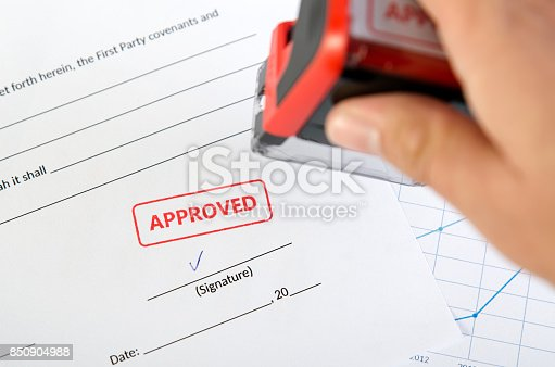 854317150istockphoto Automatic stamp on the contract document 850904988