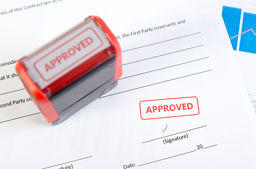 854317150 istock photo Automatic stamp on the contract document 854317150