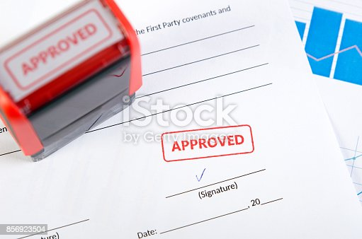 854317150istockphoto Automatic stamp on the contract document 856923504