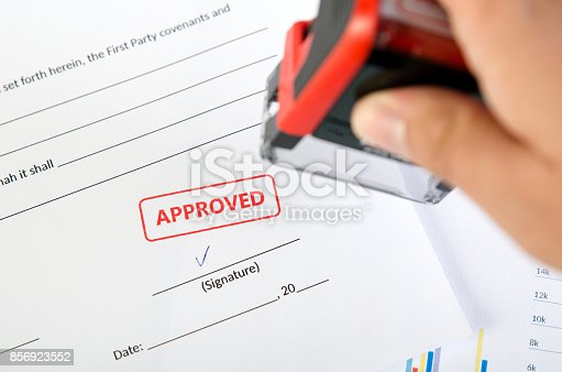 854317150istockphoto Automatic stamp on the contract document 856923552