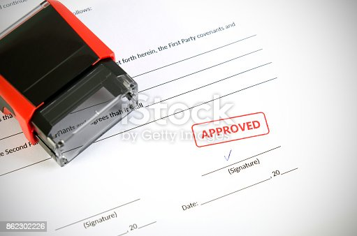 854317150istockphoto Automatic stamp on the contract document 862302226
