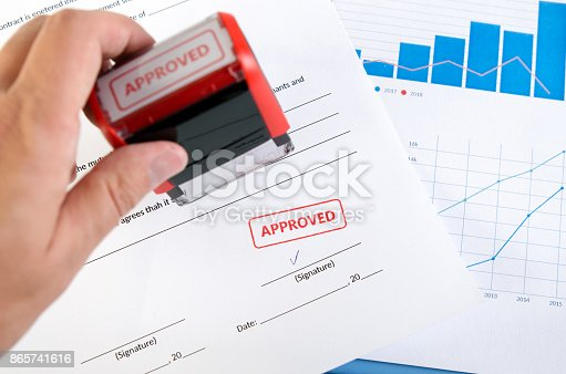 854317150istockphoto Automatic stamp on the contract document 865741616