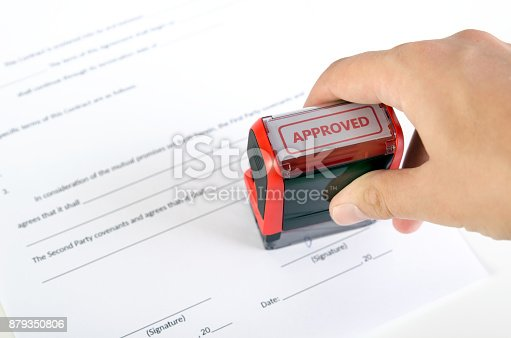 944422446istockphoto Automatic stamp on the contract document 879350806