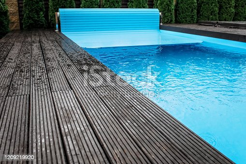 istock Automatic swimming pool covering system, home and cottage equipment 1209219920