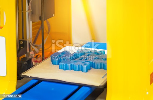 istock Automatic three dimensional 3d printer performs product creation. Modern 3D printing or additive manufacturing and robotic automation technology. 1029541870