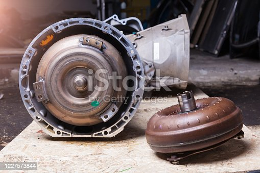 Automatic transmission with torque converter is centrifugal pump and centripetal turbine, between them guiding apparatus is a reactor. Pump wheel connected to crankshaft engine, turbine with gearbox.