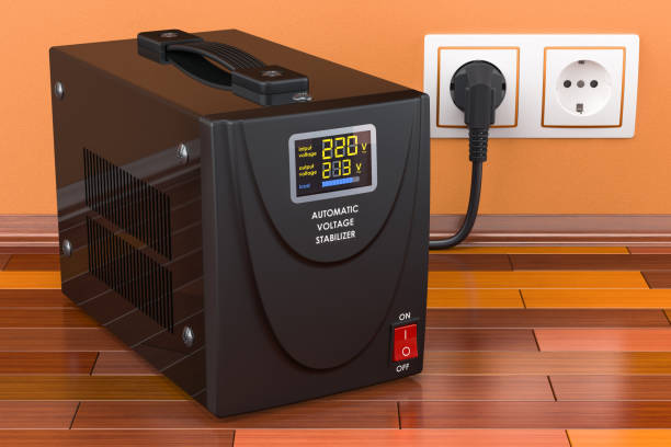 Automatic voltage stabilizer on the wooden floor connected to outlet. 3D rendering stock photo
