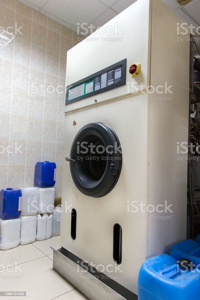 Automatic washing machines at laundry service stock photo
