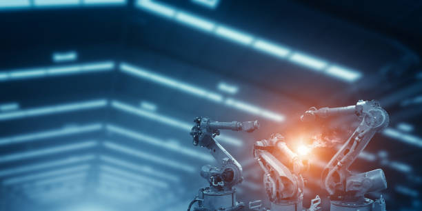 Automatic welding robot mechanical arm is working stock photo