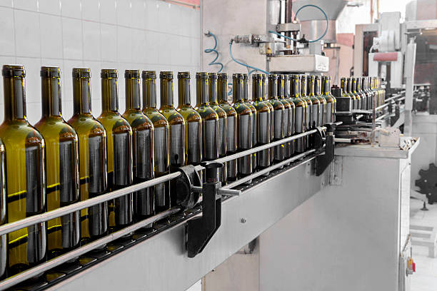 Automatic wine bottling process stock photo