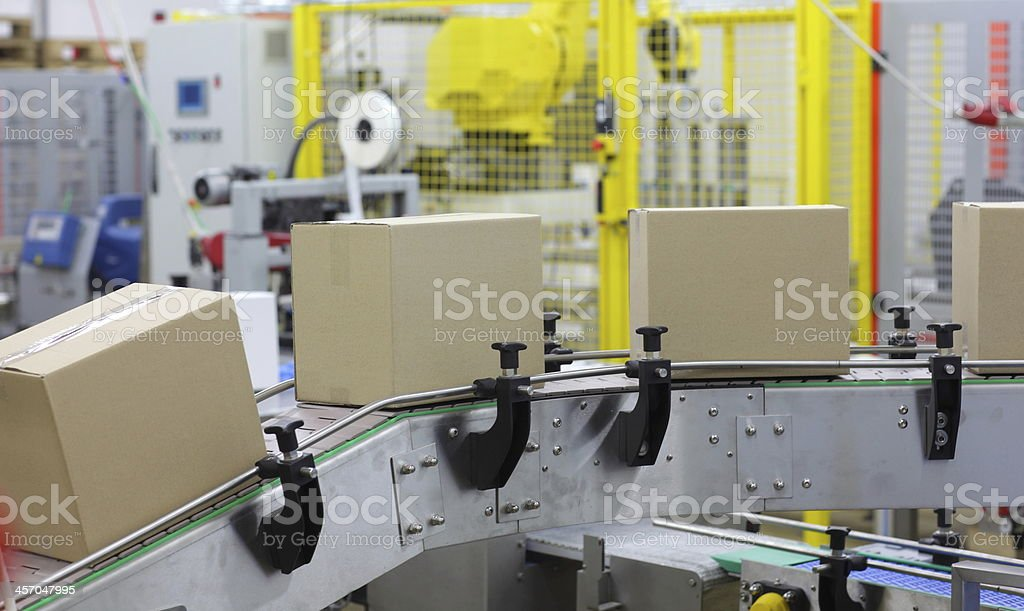automation - Cardboard boxes on conveyor belt in factory stock photo
