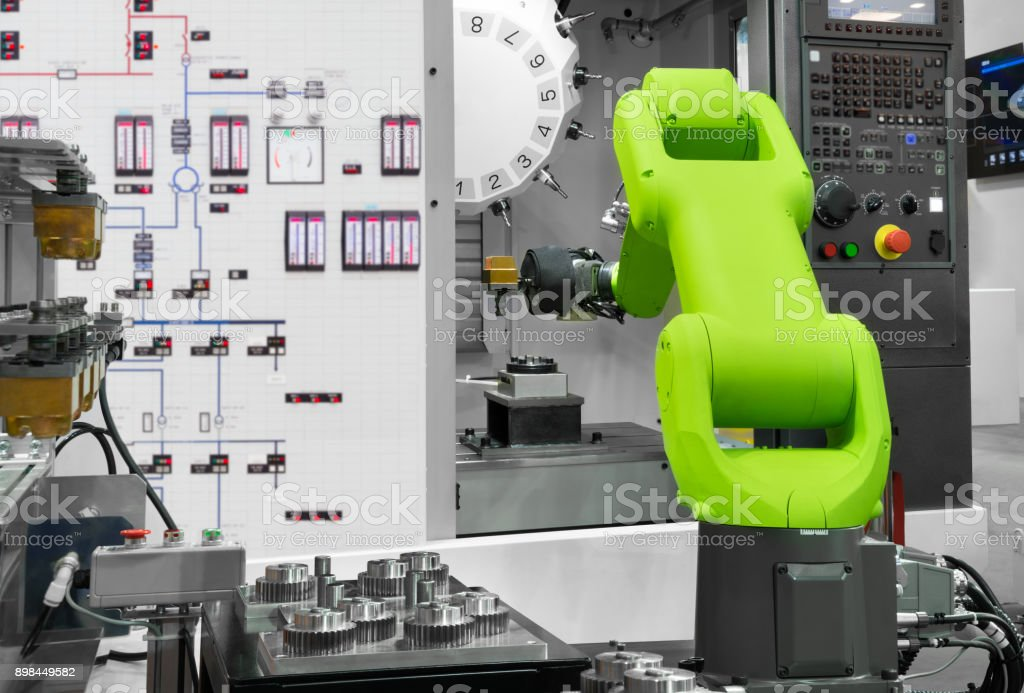 Automation robotic industry picking automotive parts with CNC machine in manufacturing stock photo