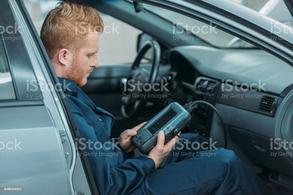 automechanic using car diagnostic tool stock photo