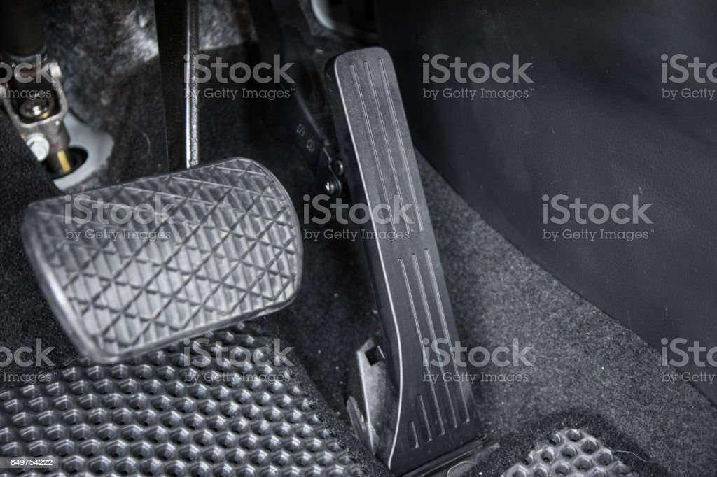 Automobile accelerator and brake pedal stock photo